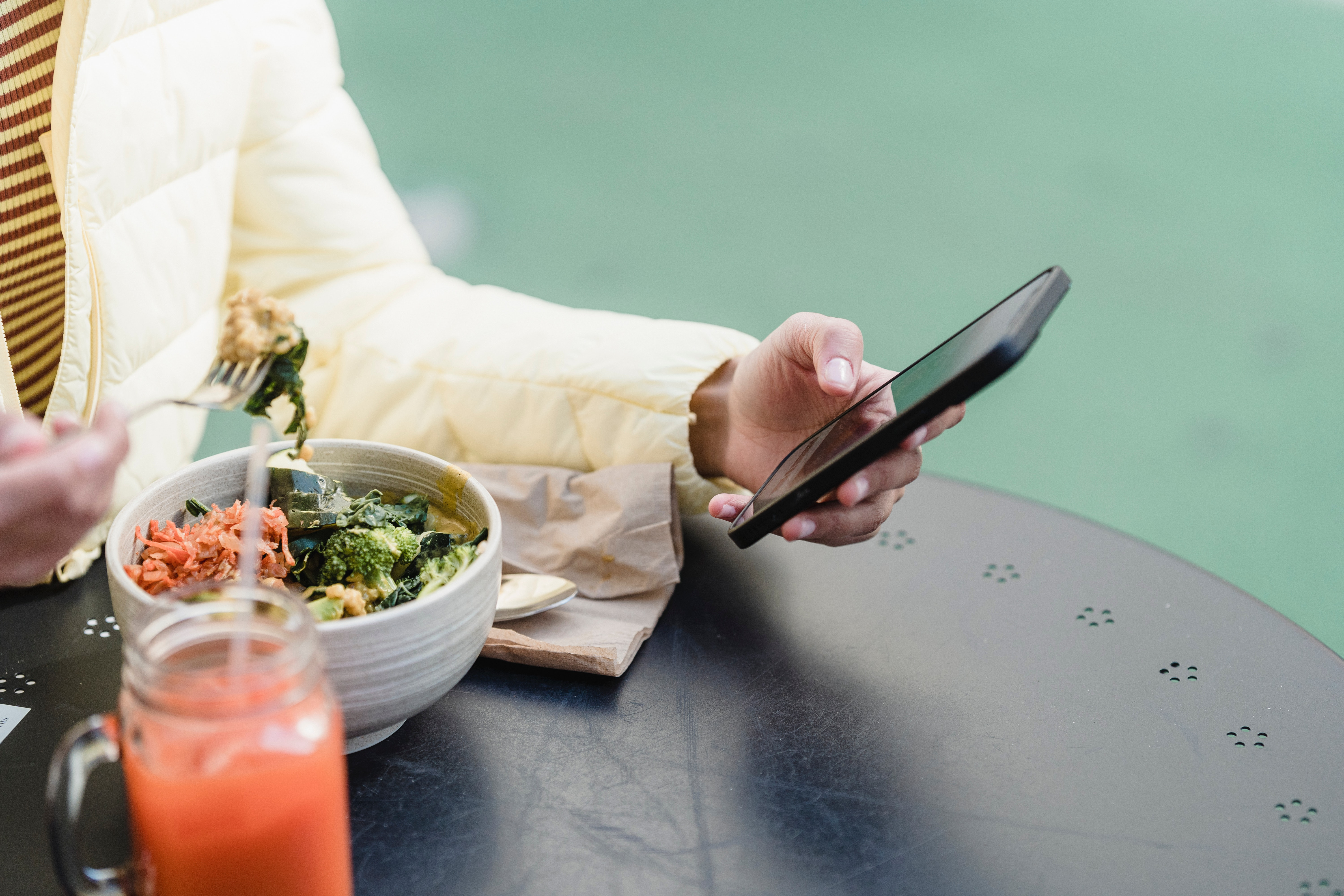 Employee accessing wellness benefits on her phone for National Wellness Month